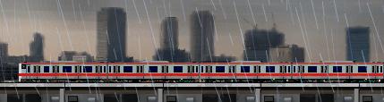 中央線の電車と雨のイラスト