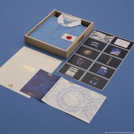 Japans 100th Anniversary shirt and it can be bought in a wooden box filled with postcards