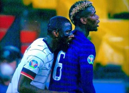 Antonio Rudiger biting Paul Pogba