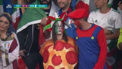 Italian couple dressed as a Pizza and Mario